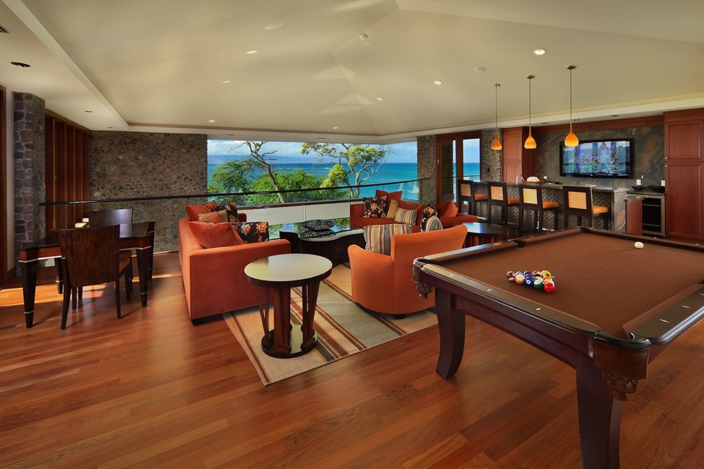 ... games room with pool, games tables and even a home sports bar awaits