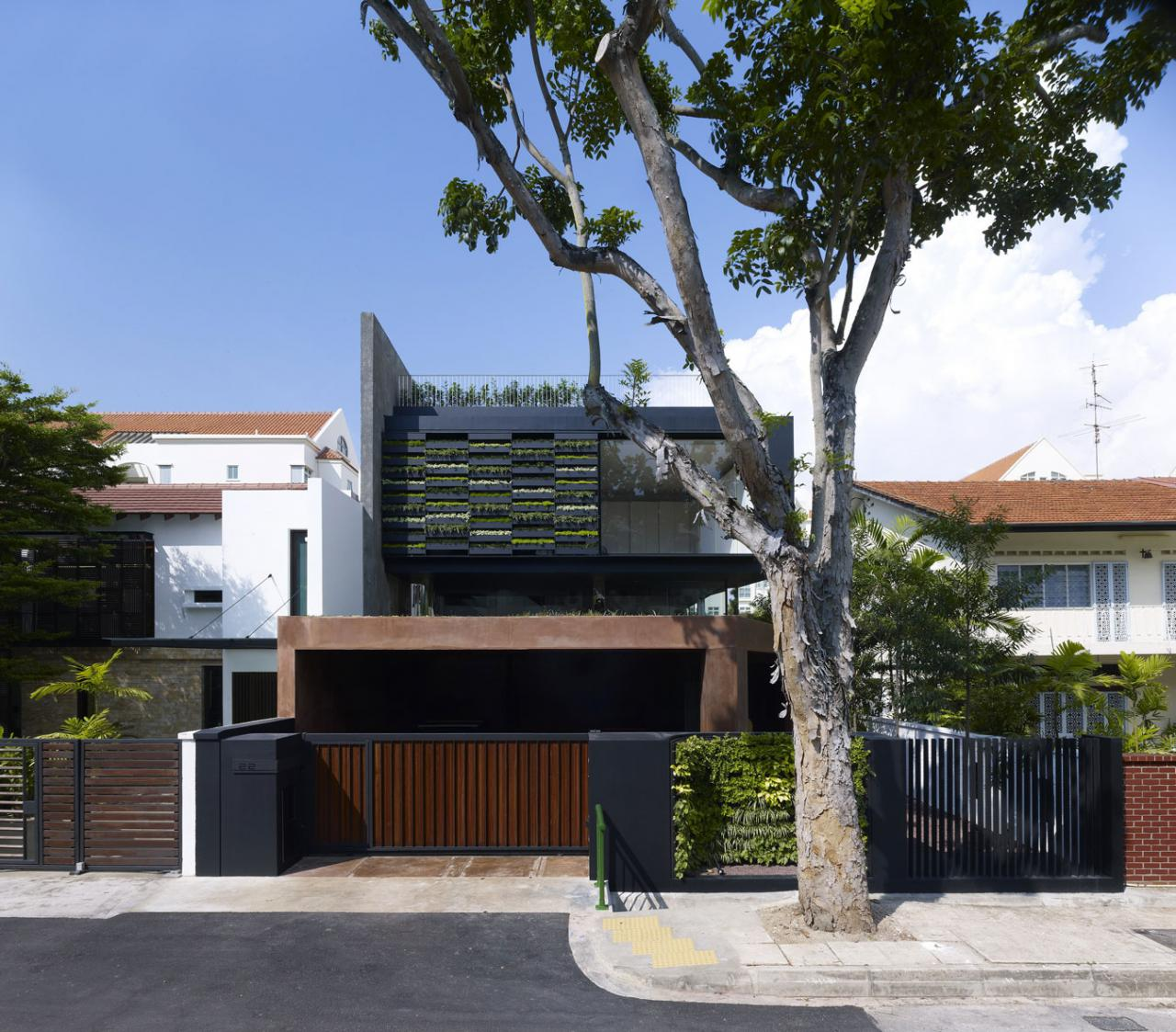 Garden House Design With Wooden Gate Wall Planters And Black Exterior ...